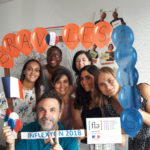 French school staff celebrating the full score for quality label FLE and France winning the World Cup