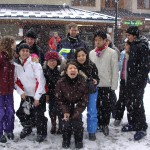 students having fun in the snow on a ski trip