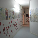 hallway at inflexyon decorated with posters and flowers