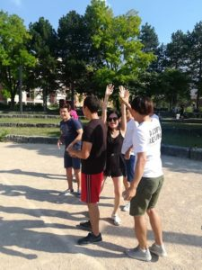 Playing petanque after French lessons in France